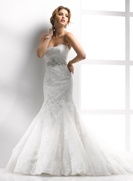 a Maggie Sottero, I really like this dress a lot...love the ivory..there isnt anything about this dress that i dont like