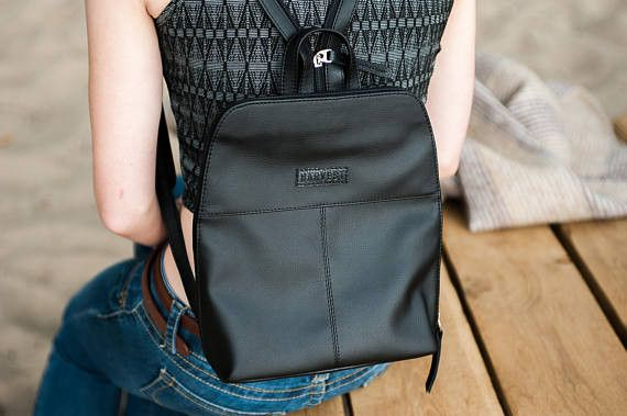 Conquer weekends with this effortlessly minimalist mini backpack. Perfectly petite, it can add an stylish accent to the everyday. It has a convenient exterior pocket and interior compartment to...