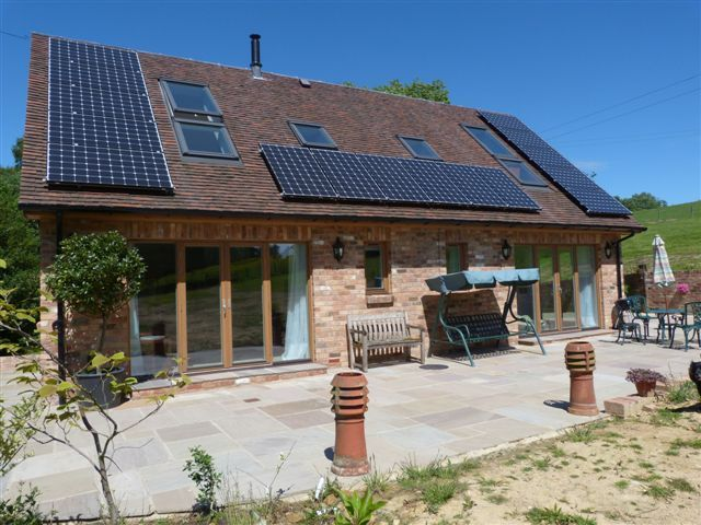 Heat Pump Case Studies; This West Kent installation features a ground  source heat pump with matched underfloor heating and a 4kW solar PV array.