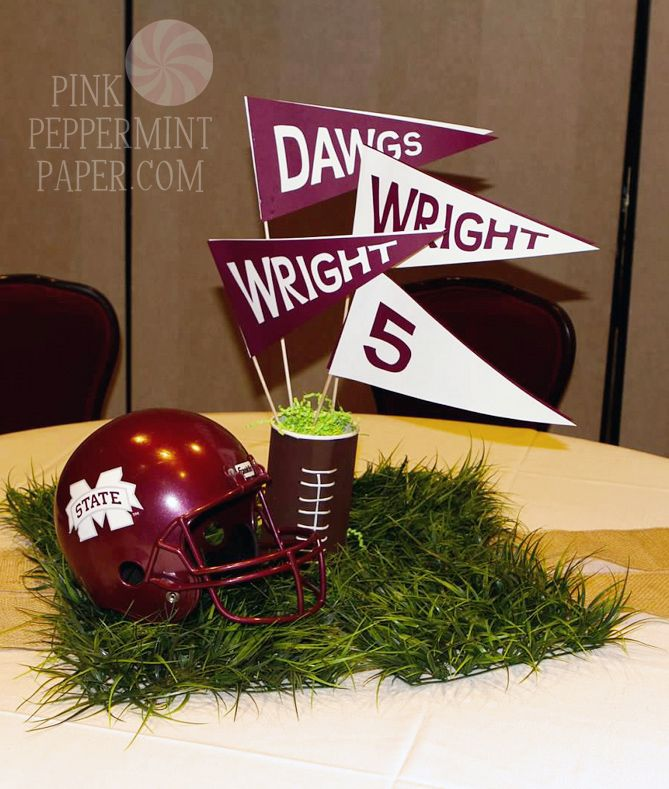football banquet centerpiece | Cheer-themed tables gave guests the spirit with flowers, megaphones ...