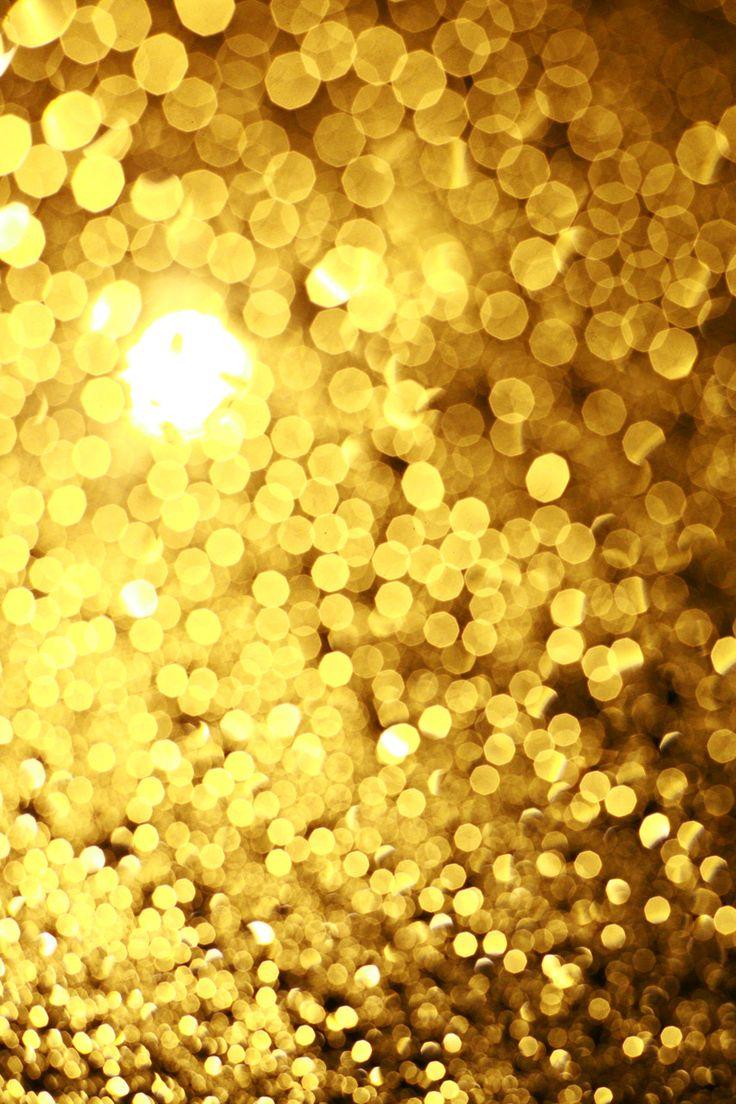 細かいまる。たくさんの金色のひかり