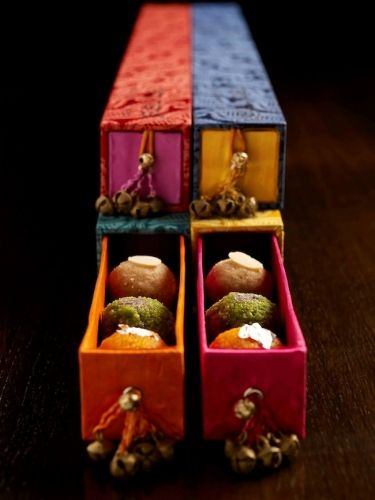 Ladoos in beautiful little boxes - to send with invites or as party favors?