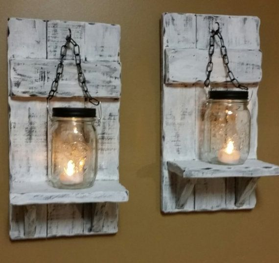 These wood shelf candle holders are made from reclaimed distressed wood. They are done in a Distressed White Washed Vintage style. The Price