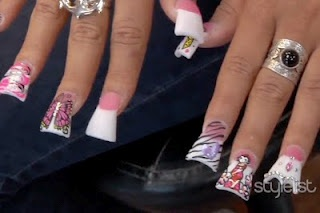 """Jerseylicious evil mind Tracy DiMarco sports these HORRIBLE nails as if they were her prized posession. I had no idea they were a """"trend""""! Read this article...*click*"""