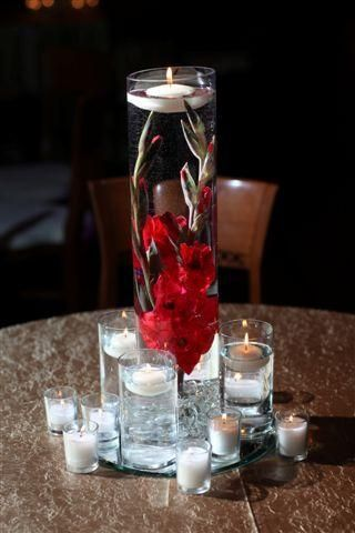 Centerpiece Featuring Sunken Gladiolus and Candles