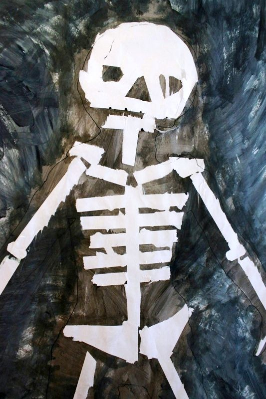 Do your kids like to do body tracings? If so, try this full-sized tape resist skeleton painting. Perfect for Halloween time! Plus it helps kids learn about their body...