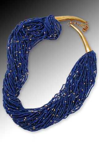 Into the Blue Fifty strands of fine denim blue Afghani lapis lazuli heishi -- artfully accented with tiny faceted 18K beads. Wear twisted torsade-style or simply hanging. 18K gold extendable clasp.