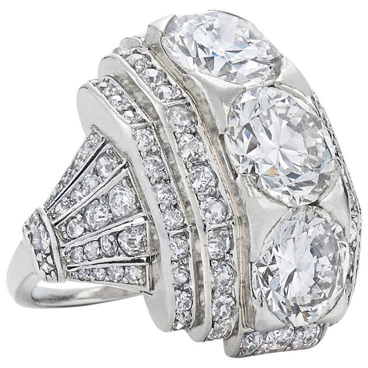 Art Deco Boivin Bande Bombe Diamond Ring. A central round diamond weighing approximately 2.15cts is flanked north and south by two round diamonds totaling approximately 3.55 carats, further accented by single cut diamonds totaling approximately 1.45cts mounted in platinum with a certificate of authenticity from renowned expert Francoise Cailles. The ring is currently a size 6-1/4 and measures approximately 7/8 inch from top to bottom. France, 1930s