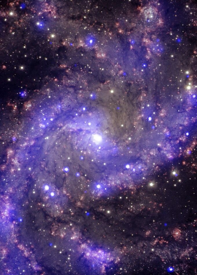 NGC 6946 The Fireworks Galaxy NGC 6946 is a medium-sized, face-on spiral galaxy about 22 million light years away from Earth. In the past century, eight supernovas have been observed to explode in the arms of this galaxy.  Image credit: X-ray: NASA/CXC/MSSL/R.Soria et al, Optical: AURA/Gemini OBs