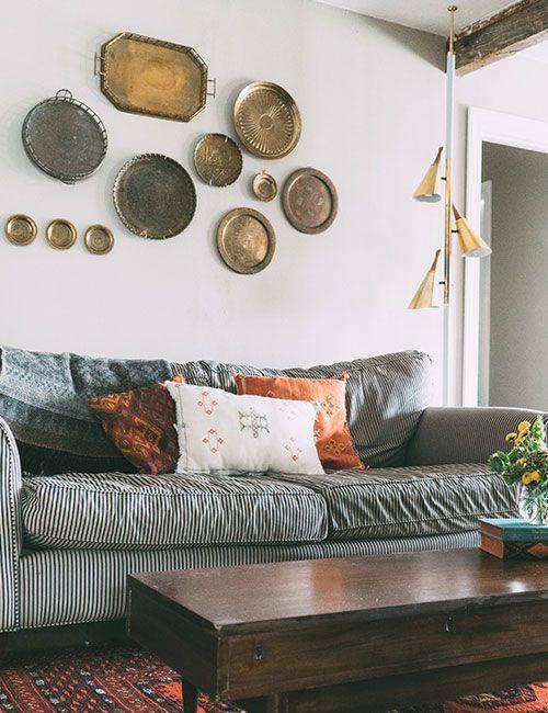 Black and white ticking stripe sofa...Worldly Influences Down South | Design*Sponge