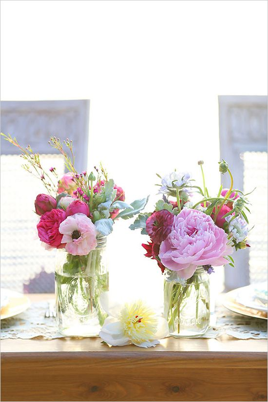 little jars with lush bouquet just over the top | wedding, decor, table