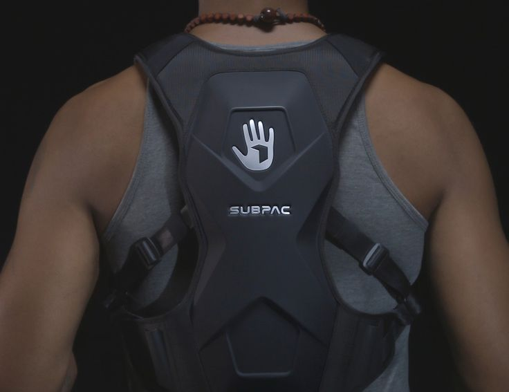 Immerse yourself in the virtual world to experience the action in real time with the SubPac M2 Wearable Bass System.