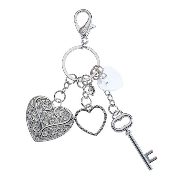 Hearts-Silver Grace Adele Clip-on    Flaunt it if you've got it! Add sparkly fun to your favorite Grace Adele bag or key ring and make a stylish statement.     •  Silver tone  •  Lobster clasp  •  Clip-on or keychain    https://myfashions.graceadele.us/GraceAdele/Buy/ProductDetails/10349  very popular and universal to everything. show your class with this clip on