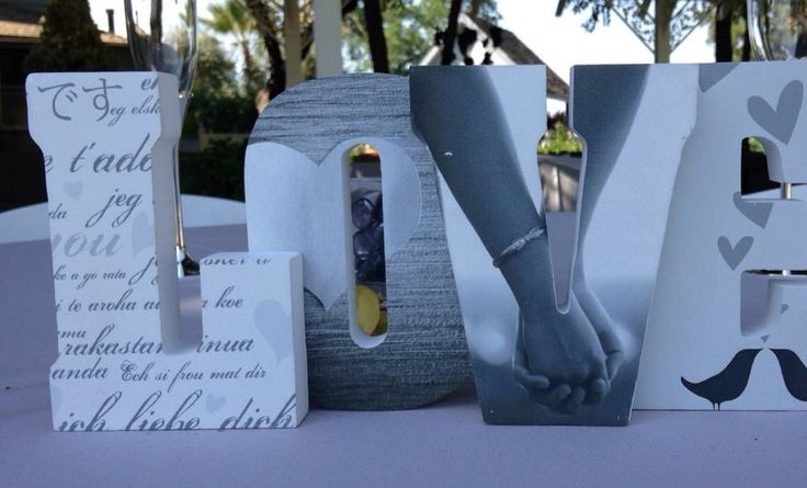 Put engagement pics in a 'love' sign