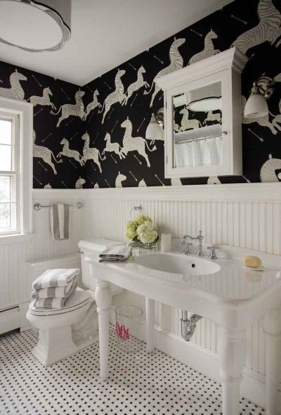 Scalamandre wallpaper makes this children's bathroom fun and sophisticated.