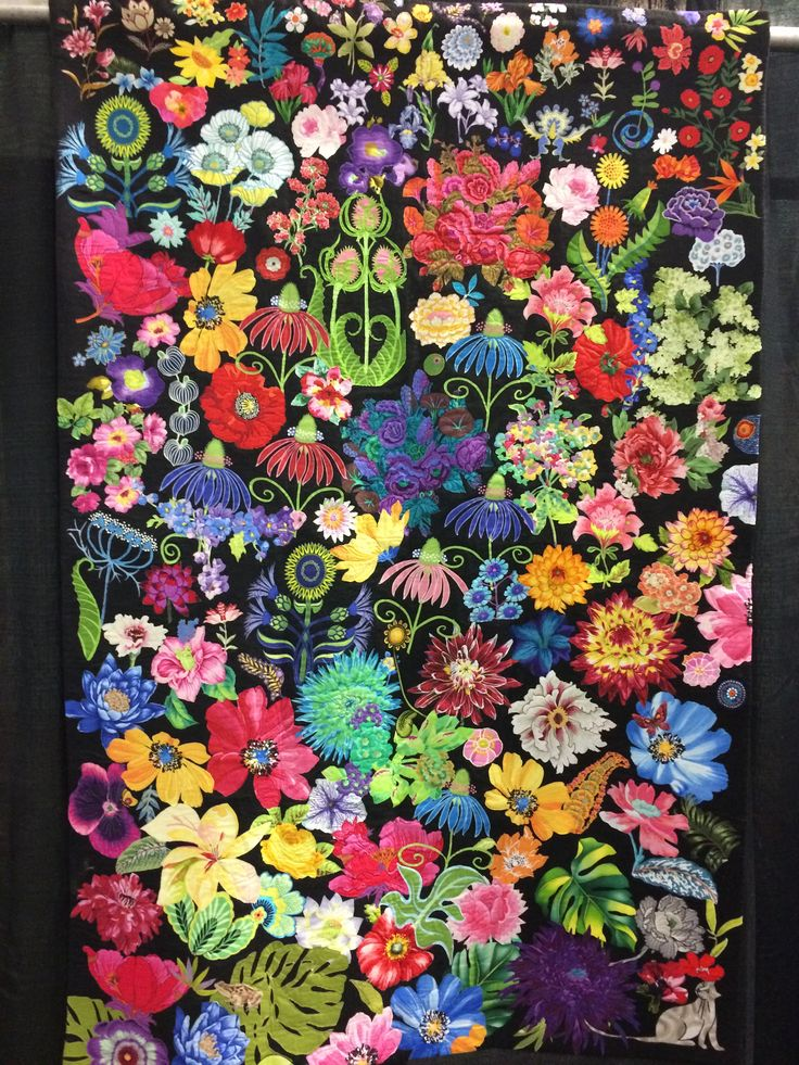 """The Spirit of Summer"" by Susan Walen from Bethesda, MD. Machine appliqued, machine quilted, original design. Susan writes: In the dead of winter, I had a total knee replacement. I spend many hours in my armchair, happily cutting flowers out of my large stash of floral fabrics. Visitors did too. Ordered a large piece of industrial black felt, and played with many arrangements of flowers from my basket. I submit what I feel was my best arrangement of colors, shapes, and negative spaces."