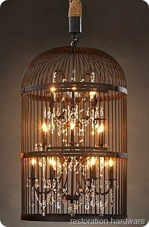 1. find old large birdcage 2. use grinder to cut out bottom 3. Find chandelier to fit inside. 4. drill hole on top to allow for wiring to be pulled. 5.twist 4 equal strands of rope around wiring and cap off also use smaller twine to wrap around for more finished look. 6. spray paint , with the rope masked