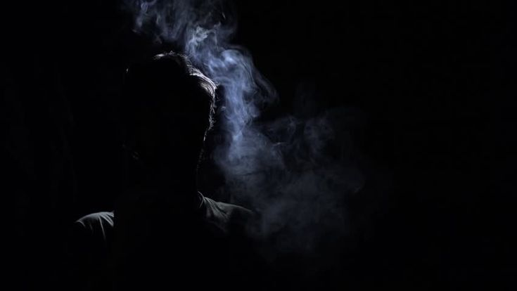 #Silhouette back lit of man smoking non stop. Back Lit Silhouette of man smoking in a dark room - 1080p - HD stock footage clip #atmospheric