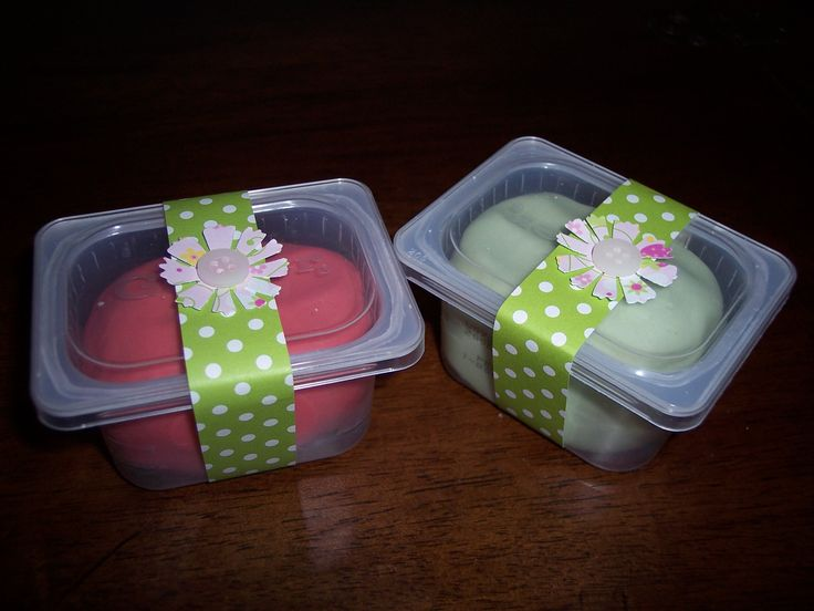 1st Birthday Favor. Reuse gerber baby food containers. Wrap with matching scrapbook paper strip, seal with punched flower, glue button on top. Fill with homemade playdough in party colors, candies, mints, chocolates, stickers, ring/necklace, hair clips/hairbands, etc.