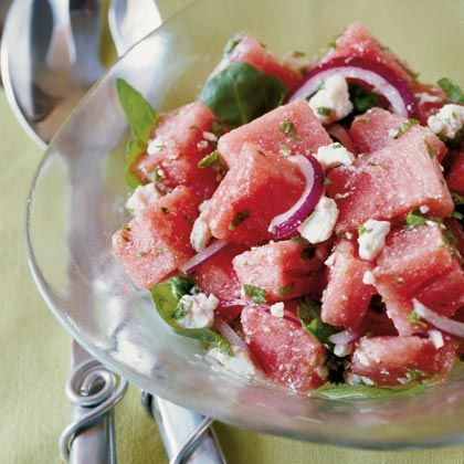 Watermelon salad with feta, onions, pine nuts and fresh herbs.
