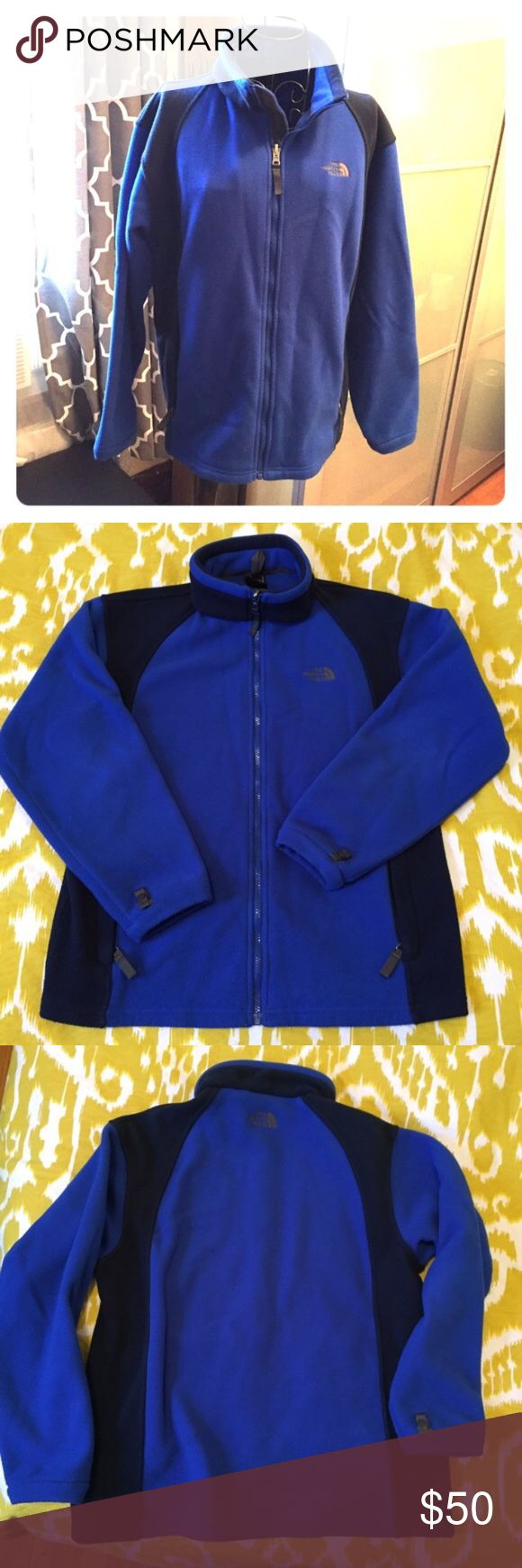 "NorthFace Fleece Jacket Bright blue with navy accents. In very good shape just some minor pilling as most fleece does. It is a straight fit and does not have the drawstring at the bottom. THIS IS ACTUALLY A BOYS EXTRA LARGE but fits like a women's medium. I am a dress size 8/10 because I have a larger chest and it fits me just fine. 22'' wide from arm pit to arm pit, 27'' long from top of collar to bottom hem, arm length is 20"" from arm pit The North Face Jackets & Coats"