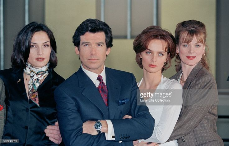 Irish actor Pierce Brosnan poses with his co-stars Famke Janssen (left), Izabella Scorupco (second from right) and Samantha Bond (right) during a publicity shoot for the James Bond film 'GoldenEye', UK, 22nd January 1995.