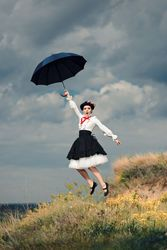 Retro Woman with Umbrella Up in The Air in Fantasy Portrait - Funny girl in vintage Edwardian costume flying
