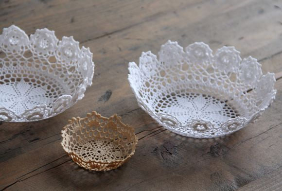 DIY lace bowl - take doily - saturate it with either fabric stiffener from craft store or make your own with 1/2 glue and 1/2 water mix - drape over glass bowl or jar let dry overnight (make sure you have something underneath (like old newspaper to catch drips) next morning you have a dry bowl - get it wet and wash it a time or too and get your doily back :)