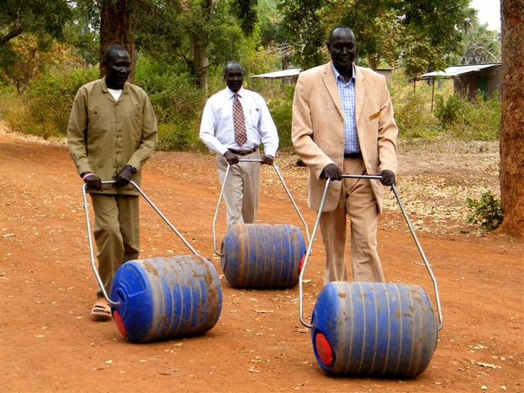 Rambek community leaders testing the Hippo rollers.