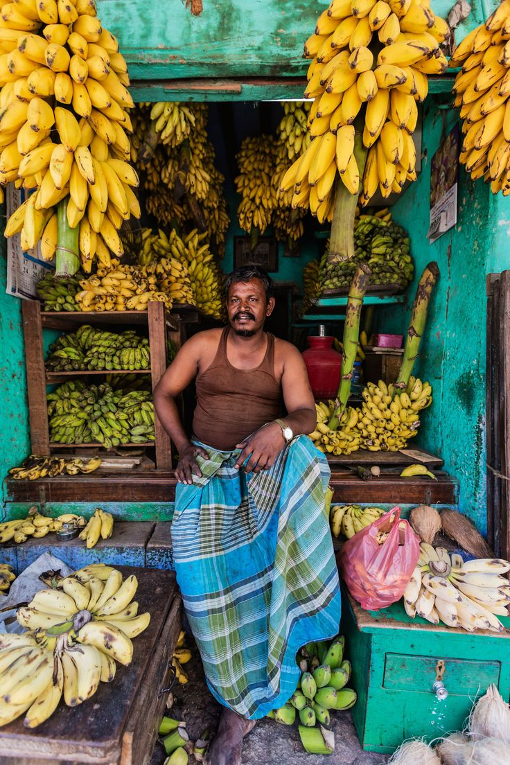 Bananas in various stages of ripeness are sold at a local market at Madurai, India.