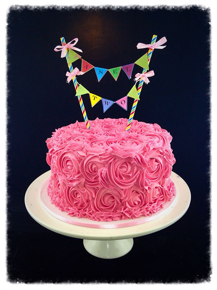 Buttercream pink rose swirl cake with bunting
