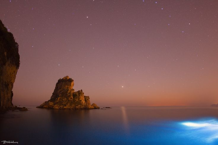 Orthololithi islet under the Stars - Orthololithi islet under the Stars Night landscape above Ortholithi islet of Pentati village, Corfu, near Ai Gordis beach. Into the sea the light of Scuba divers while above as there is Ursa Major, Leo the Lion with Jupiter, Virgo, Bootis and Libra. The reddish light on the horizon is from the lightpollution of Italy ...
