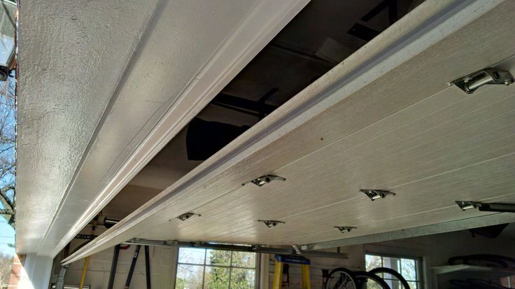Best 25 Garage Door Track Ideas On Pinterest