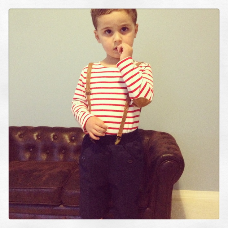 Red nautical stripe shirt with camel elbow patches paired with navy shorts and suspenders. Outfit $30.95
