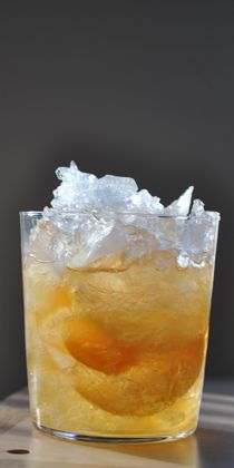 Madeira Cobbler  Recipe adapted from Bellocq, Hotel Modern, New Orleans  Makes one drink    1½ ounces Sercial Madeira (preferably from Rare Wine Co.)  ½ ounce simple syrup (1:1)  2 peels orange zest  1 peel lemon zest  Mederia Cobbler - Cracked ice  Chocolate bitters (preferably Ballast & Keel Cocoa Nib & Chile Arbol)