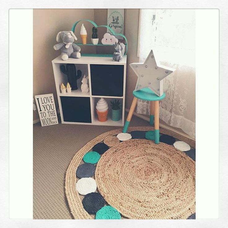 Loving this corner of @ashleigh_coulton #nursery featuring @kmartaus cloud shelf, cloud light, aqua tin pot/ plant, star light, dipped stool and she has done a fantastic #kmarthack on her jute rug and cactus by giving them a coat of paint
