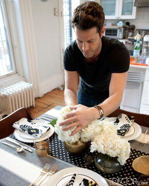 """Keep it simple. """"I think people stress about what a centerpiece needs to be,"""" says Berkus. """"I prefer to do something monochromatic—a single species of flower in three to five vases to create some movement on the table."""""""