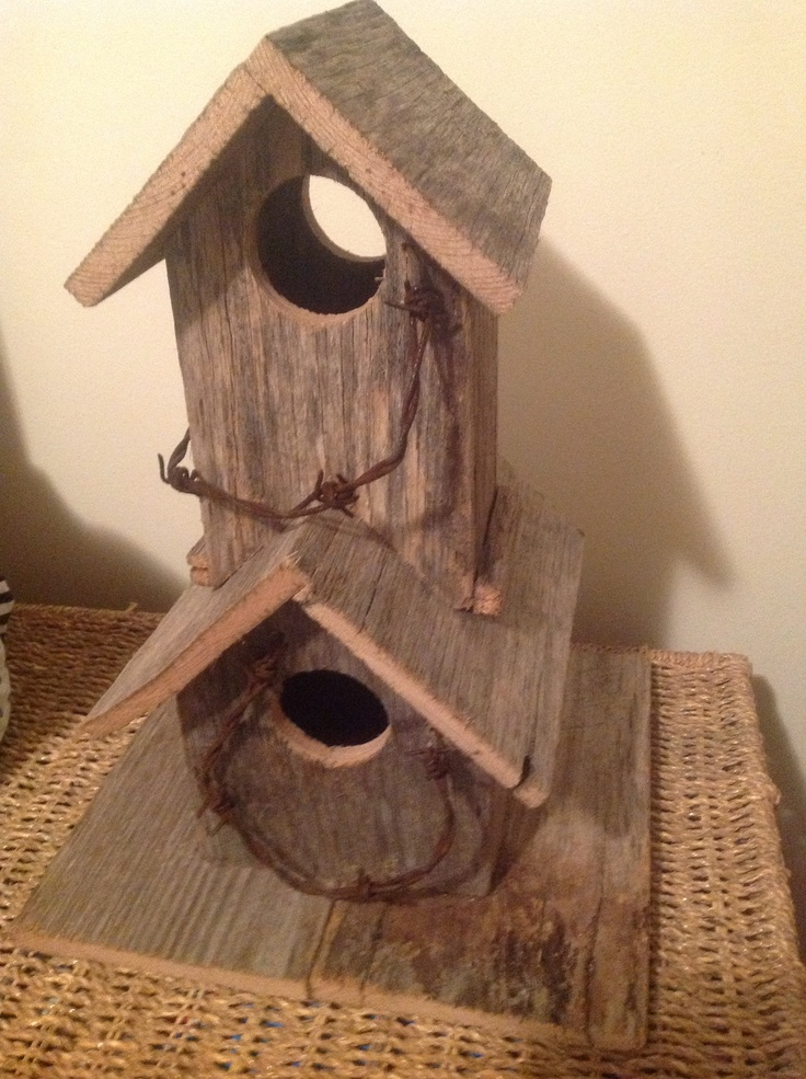 Double storey birdhouse made out of recycled fence palings and barbed wire. Cute.