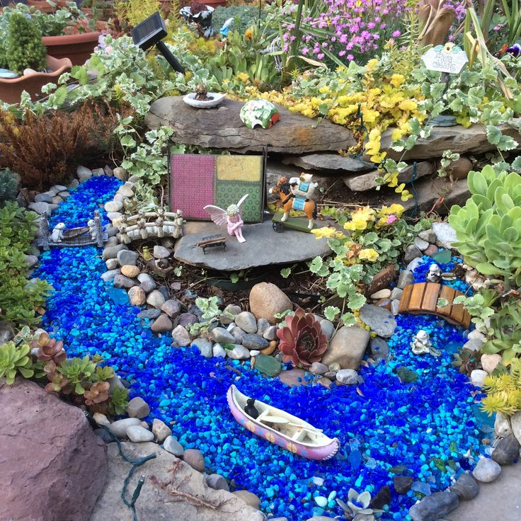 Miniature Fairy Garden With Lake And River. Candytuft Waits For Her Cat To  Come Camp