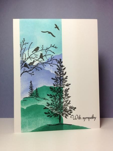 """By beesmom at Splitcoaststampers. Mask white cardstock panel to expose vertical strip. Position torn copy paper for top of lower hill; sponge from torn paper to cardstock. Repeat for other hills. Sponge sky. In black ink, stamp birds from """"Serene Silhouettes"""" (Stampin' Up) and small trees from """"Life Is Good"""" (Gina K Designs). Remove mask. Stamp large pine from """"Lovely as a Tree"""" (Stampin' Up). Sponge hill under large tree. Add sentiment."""