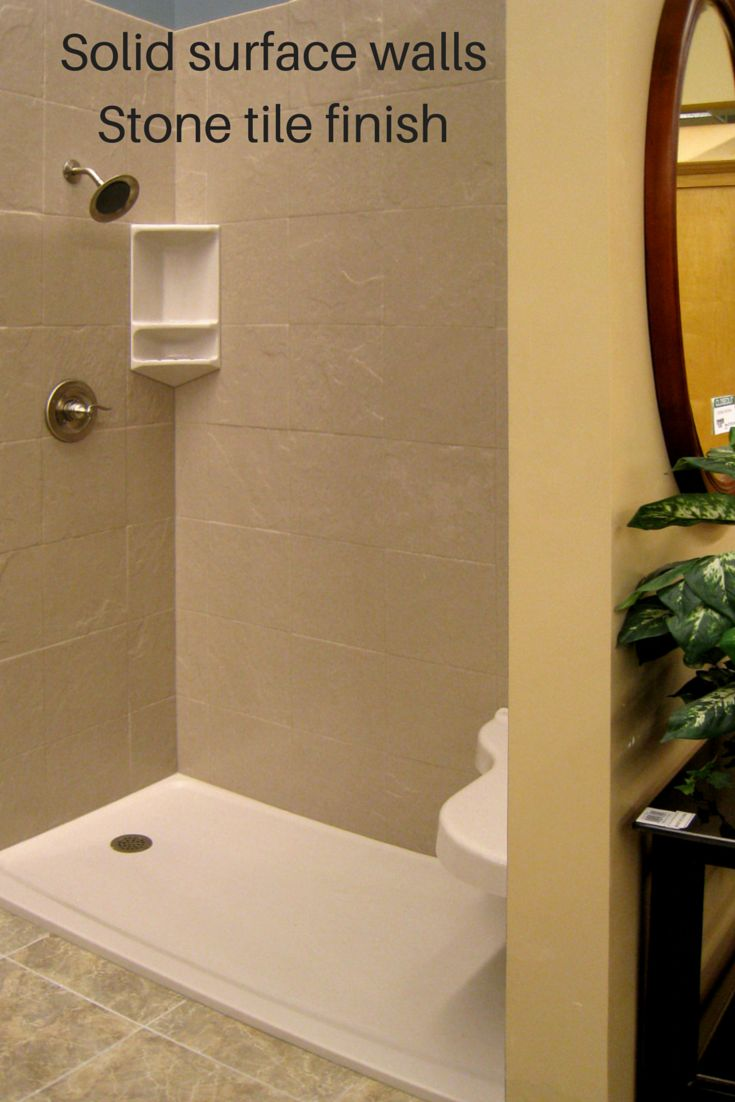 Solid surface shower wall panels are easy to install and available in DIY kits for ease of installation. They come in decorative patterns like this stone tile look - but have the advantage of no grout lines! How cool is that! #GroutFree #InnovateBuilding #DIY http://blog.innovatebuildingsolutions.com/2014/12/20/3-design-options-grout-free-diy-shower-tub-wall-panels/