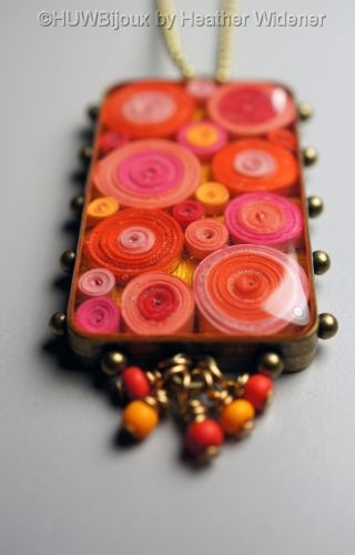 Quilled Paper glued into blank pendant tray sealed with resin DIY jewelry necklace unique style.