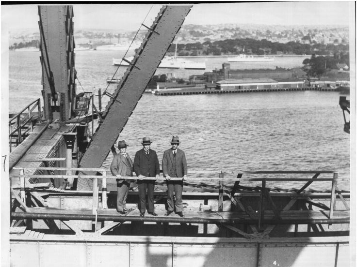 Engineer and bridge designer Dr John Bradfield with Sir William Cullen (chief justice and politician) and Mr Butler on the Sydney Harbour Bridge. 🌹