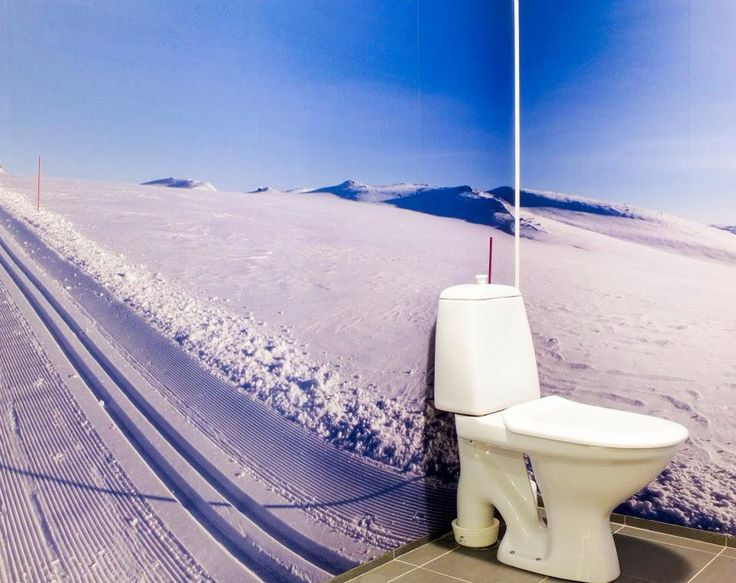 By: MOOD interiorarchitect Vibeke Sagen Dale,Norwegian Lodge. Toilet with 360' photo from Norwegian Ski Lopes from Hovden.