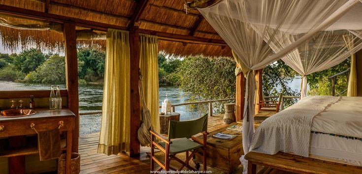 The Zambezi River flowing past one of the suites at Sindabezi Lodge, part of Tongabezi Lodge. Near Livingstone, Zambia.