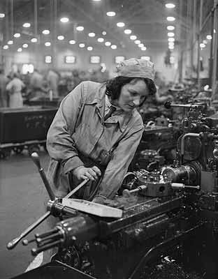 World War 2: British fighter aircraft are being produced in increasing numbers. Here are Spitfires in production, in a factory where women play an important part, and are employed in nearly all branches of construction. April 3, 1941.