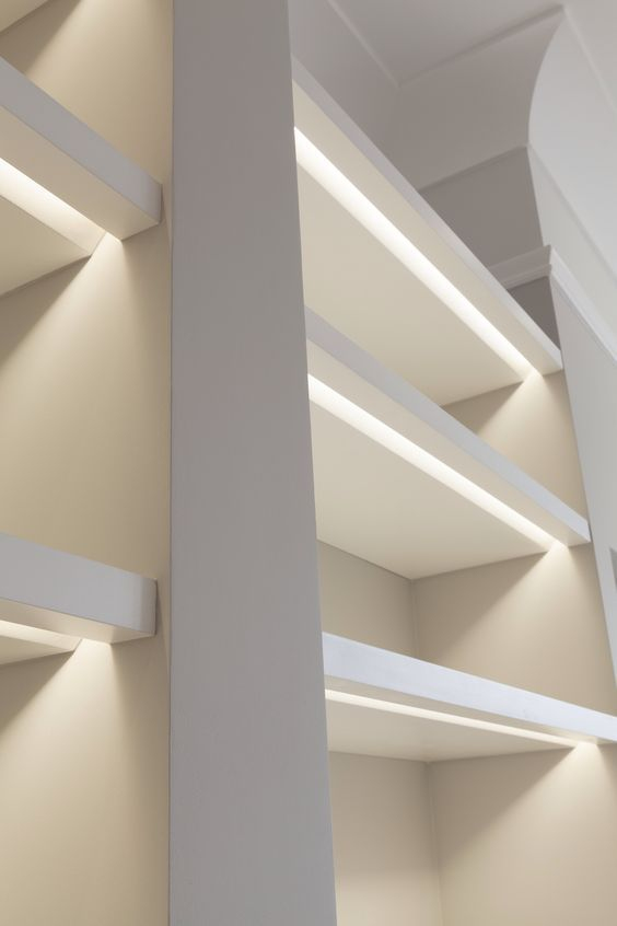 Shelves lit with recessed lights. Note the bevel to allow light to project rearward.  http://www.justleds.co.za
