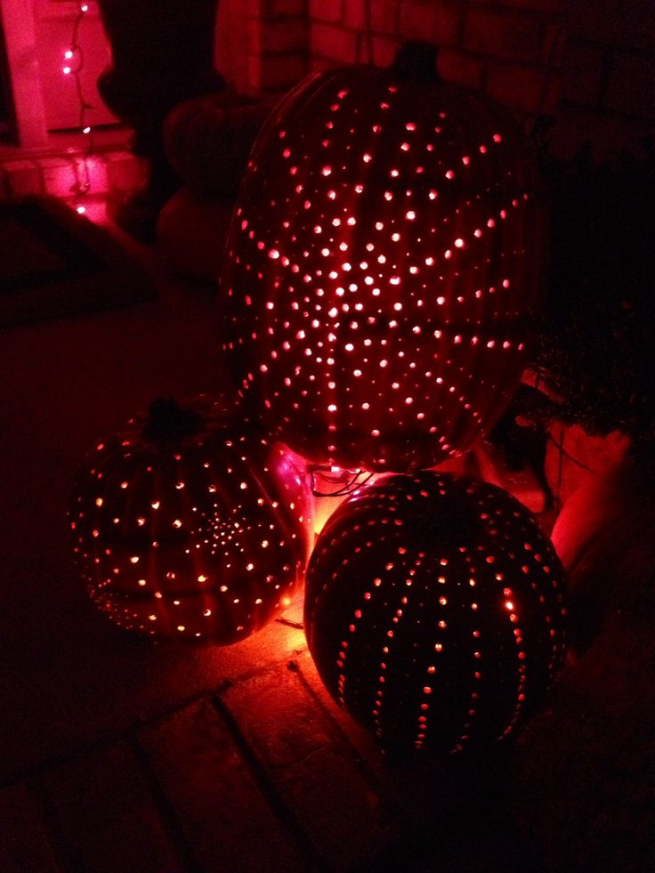 i drilled holes in pumpkins and placed twinkle lights