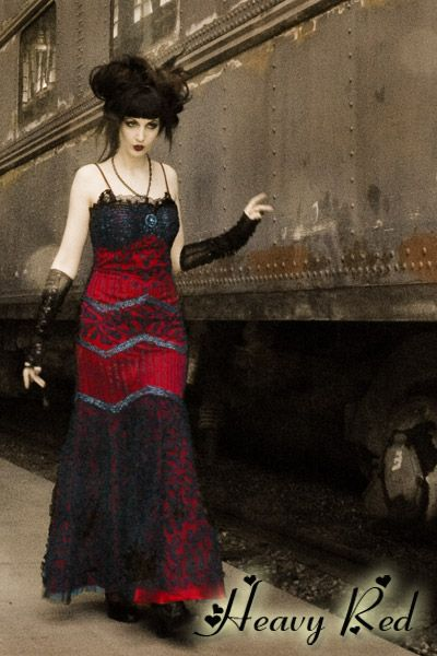 $148.00 VICTORIAN MISFIT GOWN  The trains all stopped dead in their tracks as she walked by...stunning, breathtaking and with devious intentions. Born of another time, lost in this world, she is a misfit.The Misfit Gown is deep blood red satin, covered with a net and lace overdress. The overdress is adorned with black lace, ribbon and sequins.