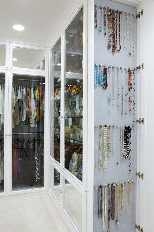 Closet with jewelry organization... loving the glass closet doors!